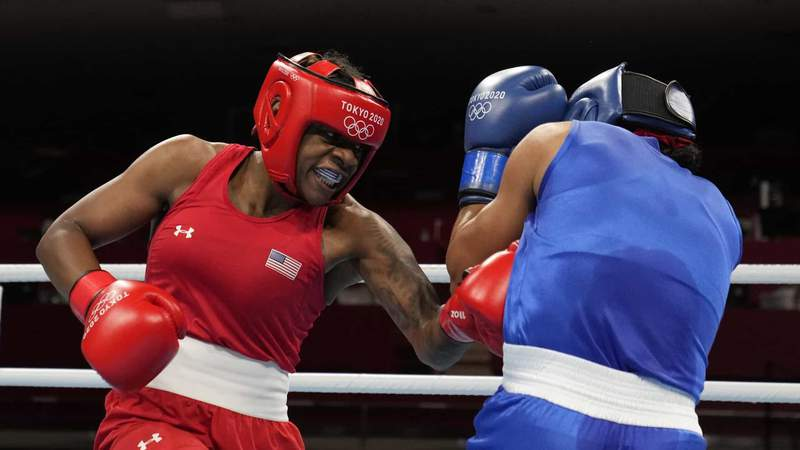 U.S. welterweight Oshae Jones digs in a body shot in her Olympic boxing quarterfinal win Friday.