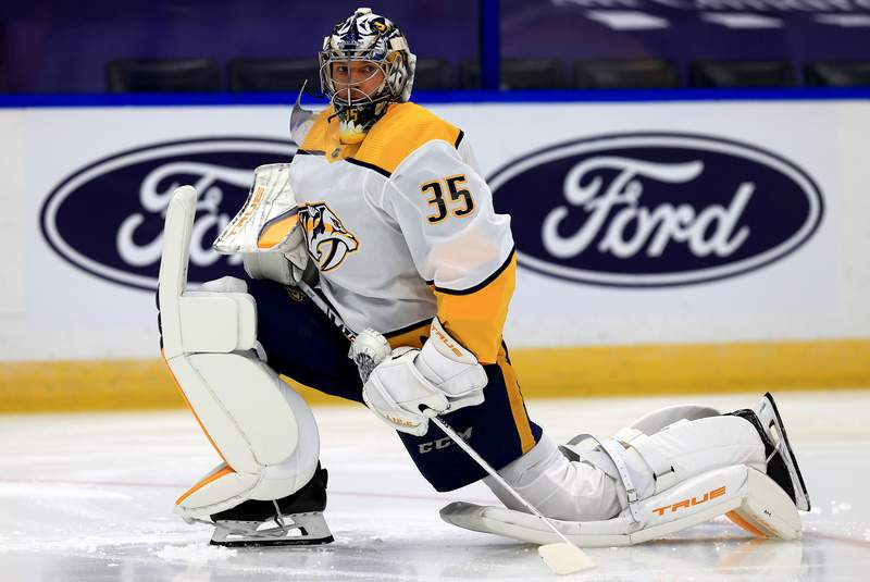 TAMPA, FLORIDA - JANUARY 30: Pekka Rinne #35 of the Nashville Predators warms up during a game against the Tampa Bay Lightning at Amalie Arena on January 30, 2021 in Tampa, Florida. (Photo by Mike Ehrmann/Getty Images)