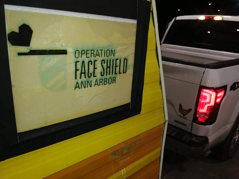 An Operation Face Shield Ann Arbor logo is seen on the trailer carrying supplies to South Dakota.