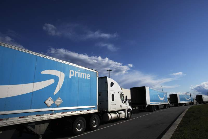 FILE - This April 21, 2020 file photo shows Amazon tractor trailers line up outside the Amazon Fulfillment Center in the Staten Island borough of New York.  One of the nations largest union is aiming to unionize Amazon workers. Representatives from the International Brotherhood of Teamsters, a union that represents 1.4 million workers, voted on Thursday, June 24, 2021,  to make organizing Amazon workers a priority.   (AP Photo/Mark Lennihan, File)