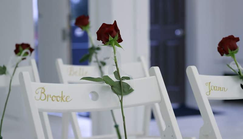 """FILE - In this Nov. 12, 2017 file photo, a memorial for the victims of the shooting at Sutherland Springs Baptist Church includes 26 white chairs, each painted with a cross and and rose and placed in the sanctuary, in Sutherland Springs, Texas. A federal judge ruled Wednesday, July 7, 2021, the U.S. Air Force was """"60% responsible"""" for the attack at First Baptist Church in Sutherland Springs because it failed to submit Devin Kelley's criminal history into a database, which should have prevented the gunman from purchasing the weapon used in the attack. (AP Photo/Eric Gay, File)"""