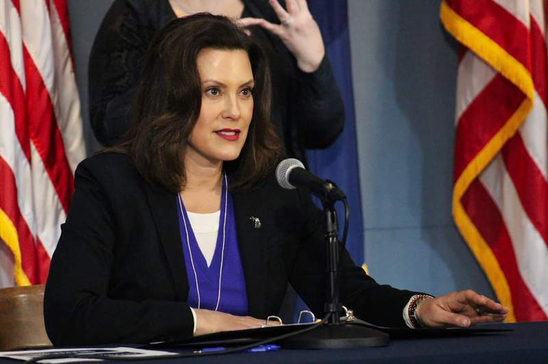This photo provided by the Michigan Office of the Governor, Michigan Gov. Gretchen Whitmer addresses the state during a speech in Lansing, Mich., Friday, April 17, 2020. Whitmer said she hopes to gradually begin reopening the state's economy on May 1 after weeks of a strict stay-at-home order that has crippled businesses and caused more than 1 million unemployed people to seek aid during the coronavirus crisis. (Michigan Office of the Governor via AP, Pool)