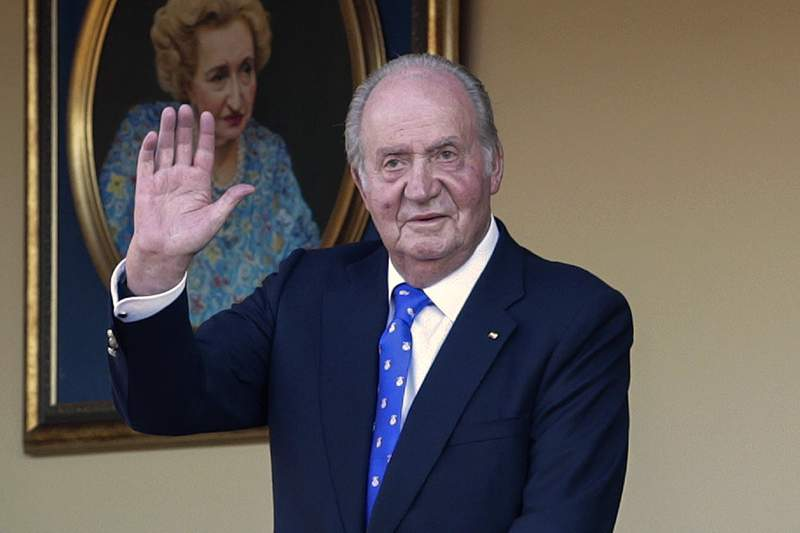 FILE - In this Sunday, June 2, 2019 file photo, Spain's former King Juan Carlos waves during a bullfight at the bullring in Aranjuez, Madrid, Spain. Spanish Supreme Court prosecutors have taken over a new investigation into the financial activities of ex-King Juan Carlos, it was announced Tuesday, Nov. 3, 2020. The former king recently left Spain to live in an unspecified country following the opening of probes against him in Spain and Switzerland. (AP Photo/Andrea Comas, File)