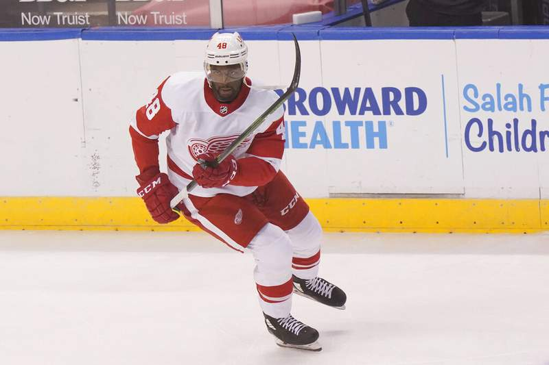 Detroit Red Wings right wing Givani Smith warms up before the start of an NHL hockey game against the Florida Panthers, Sunday, Feb. 7, 2021, in Sunrise, Fla. (AP Photo/Wilfredo Lee)