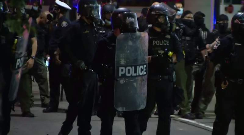 Detroit police officers were in riot gear Friday night.