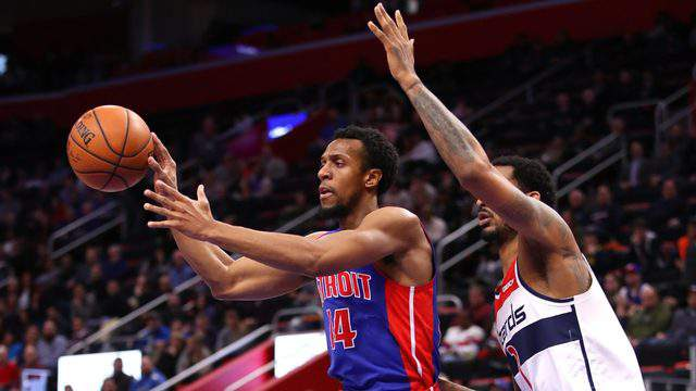 DETROIT, MICHIGAN - FEBRUARY 11: Ish Smith #14 of the Detroit Pistons passes away from Trevor Ariza #1 of the Washington Wizards during the second half at Little Caesars Arena on February 11, 2019 in Detroit, Michigan. Detroit won the game 121-112.  (Photo by Gregory Shamus/Getty Images)