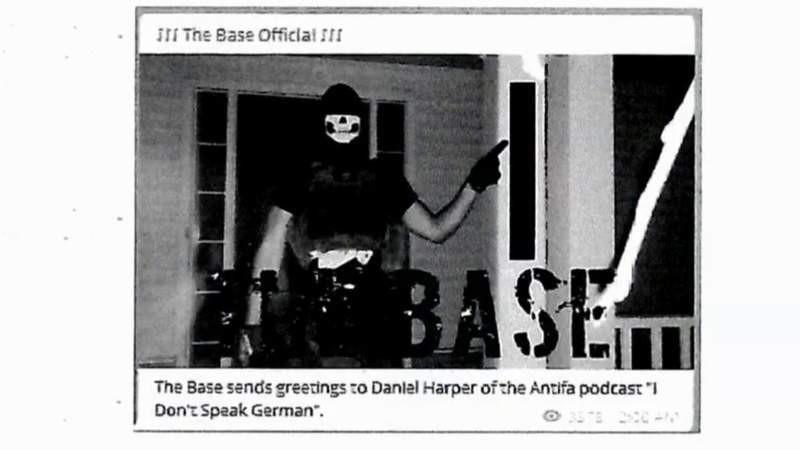 """A screenshot of a picture uploaded to social media by former The Base leader Justen Watkins in an effort to threaten a podcast host. The photo of Watkins was taken in front of a family's home in Dexter Township in 2019, where Watkins falsely believed the """"I Don't Speak German"""" podcast host lived."""