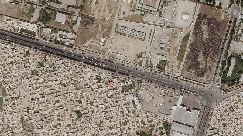 In this satellite photo taken by Planet Labs Inc., a Taliban checkpoint is seen blocking access just south of Kabul's international airport Saturday, Aug. 28, 2021. Taliban forces sealed off Kabul's airport Saturday to most Afghans hoping for evacuation, as the U.S. and its allies were ending a chaotic airlift that will end their troops' two decades in Afghanistan. (Planet Labs Inc. via AP)