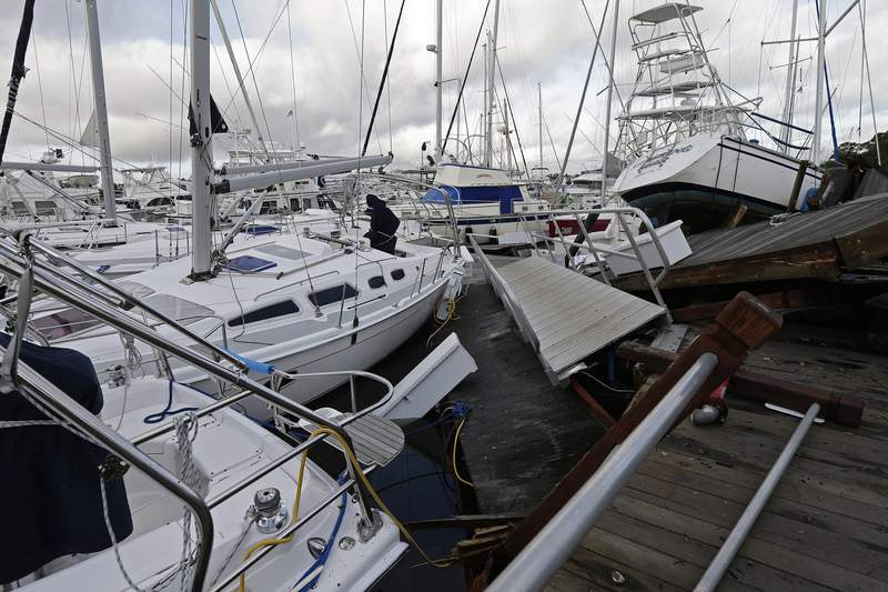 FILE - Boats are piled on each other in the marina following the effects of Hurricane Isaias in Southport, N.C., Tuesday, Aug. 4, 2020.  Hurricane season has already been busy this year, but forecasters say it should get even nastier soon. The National Oceanic and Atmospheric Administration Thursday, Aug. 6 increased its forecast for the number of named storms, hurricanes and major hurricanes this year to far above normal. (AP Photo/Gerry Broome, File)