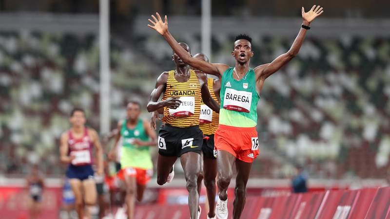 TOKYO, JAPAN - JULY 30: Selemon Barega of Team Ethiopia celebrates winning gold in the Men's 10,000 metres Final on day seven of the Tokyo 2020 Olympic Games at Olympic Stadium on July 30, 2021 in Tokyo, Japan. (Photo by Christian Petersen/Getty Images)