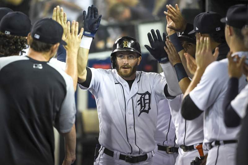 DETROIT, MICHIGAN - JULY 20: Robbie Grossman #8 of the Detroit Tigers celebrates his home run against the Texas Rangers in the bottom of the first inning at Comerica Park on July 20, 2021 in Detroit, Michigan. (Photo by Nic Antaya/Getty Images)