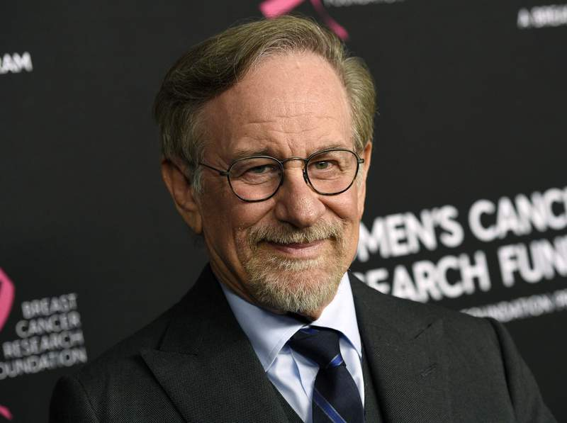 """FILE - Filmmaker Steven Spielberg poses at the 2019 """"An Unforgettable Evening"""" benefiting the Women's Cancer Research Fund in Beverly Hills, Calif. on Feb. 28, 2019. Spielberg has set a new deal with Netflix in which his production company, Amblin Partners, will make multiple feature films per year for the streaming giant.  (Photo by Chris Pizzello/Invision/AP, File)"""