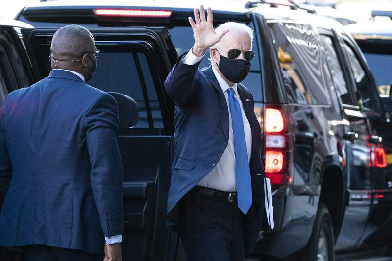 President-elect Joe Biden waves as he arrives The Queen theater for a meeting with Vice President-elect Kamala Harris, Senate Minority Leader Chuck Schumer of N.Y., and House Speaker Nancy Pelosi of Calif., Friday, Nov. 20, 2020, in Wilmington, Del. (AP Photo/Alex Brandon)