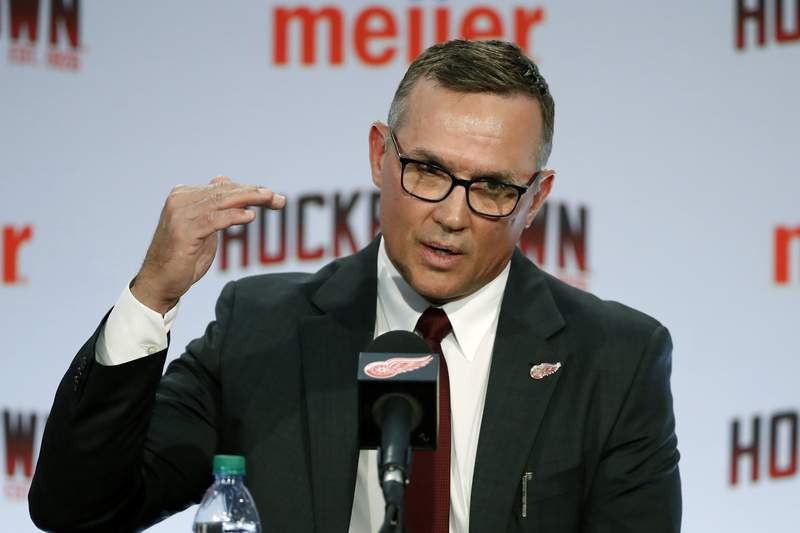 FILE - In this April 19, 2019, file photo, Steve Yzerman answers a question during an NHL hockey news conference where he was introduced as the new executive vice president and general manager of the Detroit Red Wings, in Detroit.  (AP Photo/Carlos Osorio, File)