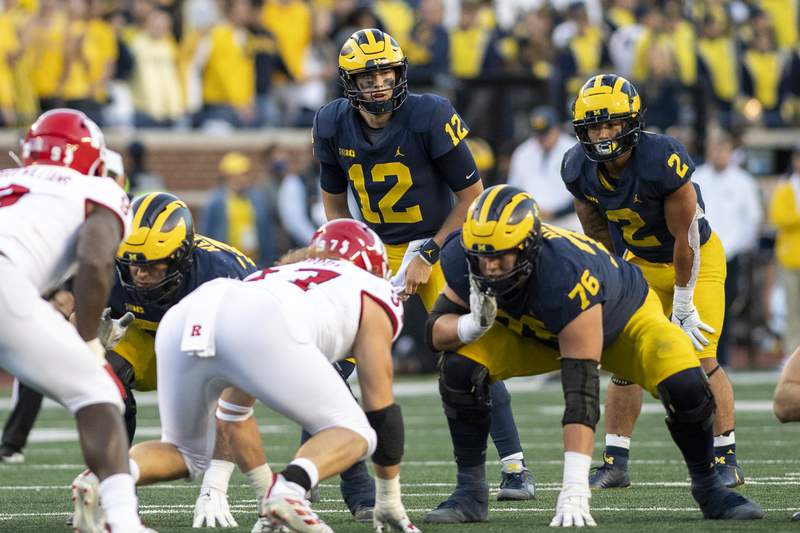 Quarterback Cade McNamara #12 of the Michigan Wolverines calls a play during the third quarter of a game against the Rutgers Scarlet Knights at Michigan Stadium on September 25, 2021 in Ann Arbor, Michigan.