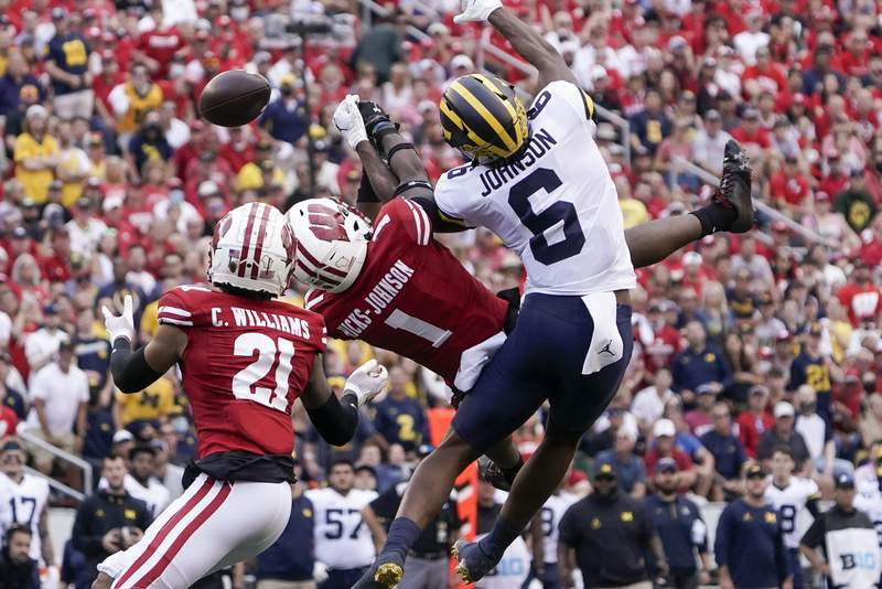 Wisconsin's Faion Hicks breaks up a pass intended for Michigan's Cornelius Johnson during the first half of an NCAA college football game Saturday, Oct. 2, 2021, in Madison, Wis. (AP Photo/Morry Gash)