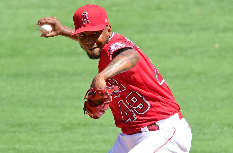 Julio Teheran #49 of the Los Angeles Angels pitches in the game against the Texas Rangers at Angel Stadium of Anaheim on September 20, 2020 in Anaheim, California.