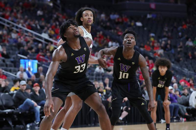 LAS VEGAS, NEVADA - MARCH 11:  Isaiah Stewart #33 and Elijah Hardy #10 of the Washington Huskies defending a rebound against Zeke Nnaji #22 of the Arizona Wildcats during the first round of the Pac-12 Conference basketball tournament at T-Mobile Arena on March 11, 2020 in Las Vegas, Nevada. (Photo by Leon Bennett/Getty Images)