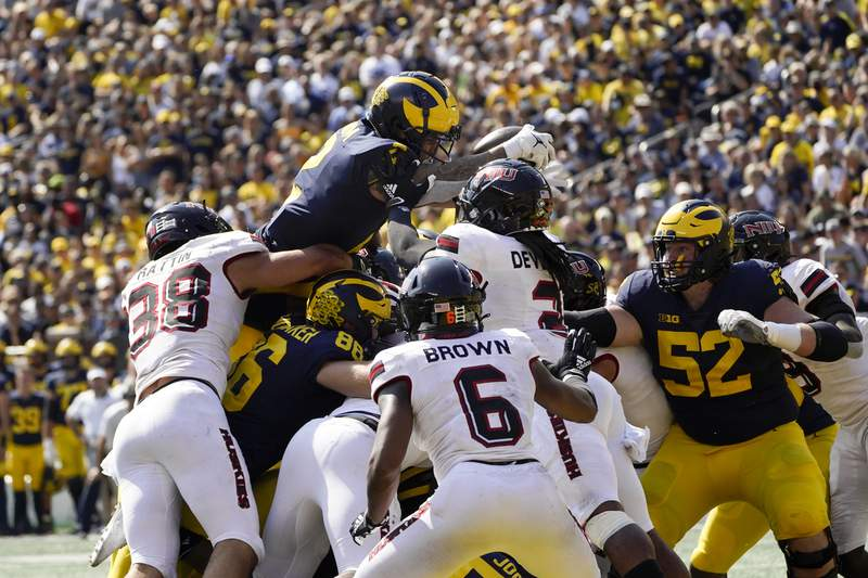 Michigan running back Blake Corum (2) dives for a one-yard touchdown run against Northern Illinois in the second half of a NCAA college football game in Ann Arbor, Mich., Saturday, Sept. 18, 2021.