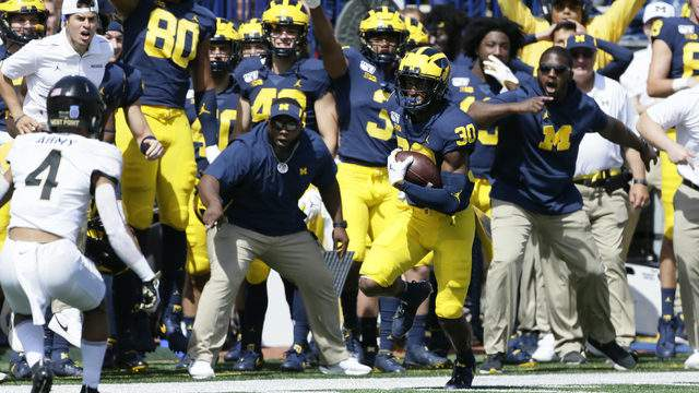 Daxton Hill #30 of the Michigan Wolverines carries the ball after making a catch against the Army Black Knights on a fake punt during the first half at Michigan Stadium on September 7, 2019 in Ann Arbor, Michigan. (Photo by Duane Burleson/Getty Images)
