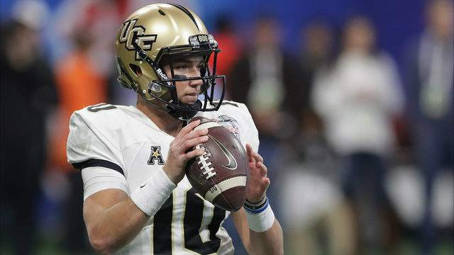 McKenzie Milton #10 of the UCF Knights looks to pass in the second half against the Auburn Tigers during the Chick-fil-A Peach Bowl at Mercedes-Benz Stadium on January 1, 2018 in Atlanta, Georgia. (Photo by Streeter Lecka/Getty Images)