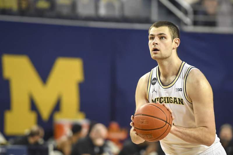 Hunter Dickinson #1 of the Michigan Wolverines shoots a free throw against the UCF Knights during the second half at Crisler Arena on December 06, 2020 in Ann Arbor, Michigan.