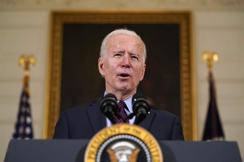 FILE - In this Friday, Feb. 5, 2021, file photo, President Joe Biden speaks in the State Dining Room of the White House, in Washington. (AP Photo/Alex Brandon, File)
