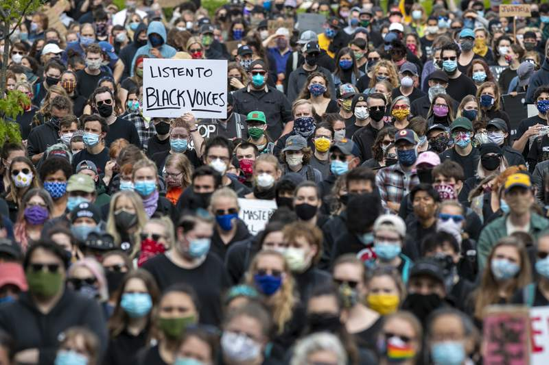 Demonstrators gather at a rally to peacefully protest and demand an end to institutional racism and police brutality, Wednesday, June 3, 2020, in Portland, Maine. (AP Photo/Robert F. Bukaty)
