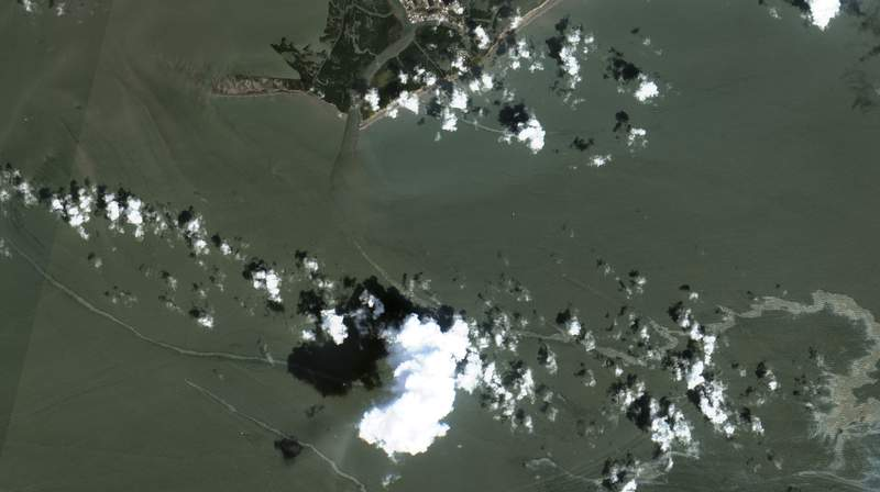 In a satellite image provided by Maxar Technologies, an oil slick is shown on Sept. 2, 2021 south of Port Fourchon, La. as a result of Hurricane Ida. U.S. industrial production slowed in August to a 0.4% gain in August as the shutdowns caused by Hurricane Ida took a toll on manufacturing activity. The Federal Reserve reported Wednesday, Sept. 15, 2021 that plant closures forced by Ida for petrochemicals, petroleum refining and other operations along the Gulf Coast had shaved 0.3 percentage point from the output figure. The small August gain was just half the 0.8% output increase in July. (Maxar Technologies via AP)