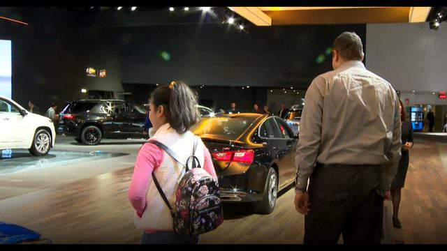 Children visit the Detroit auto show on a snow day. (WDIV)