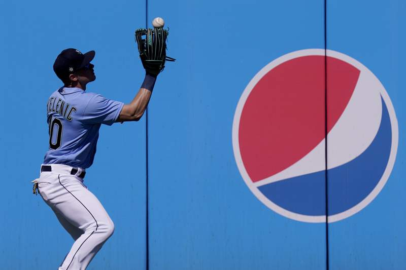 Seattle Mariners Jarred Kelenic fields an RBI double by Cleveland Indians' Josh Naylor during the first inning of a spring training baseball game Tuesday, March 2, 2021, in Peoria, Ariz. (AP Photo/Charlie Riedel)