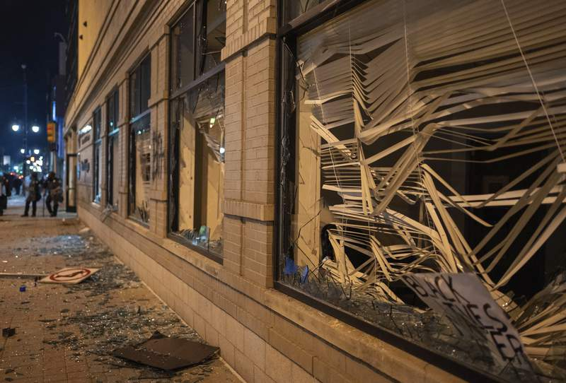 Damage is pictured to the Secretary of State building in downtown Grand Rapids, Mich., Saturday, May 30, 2020, following protests against the death of George Floyd, who died May 25 after he was pinned at the neck by a Minneapolis police officer. (Anntaninna Biondo/The Grand Rapids Press via AP)
