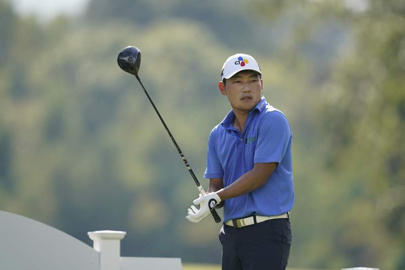 Sung Kang of South Korea adjusts his glove prior to driving off the 18th tee during the second round of the Sanderson Farms Championship golf tournament in Jackson, Miss., Friday, Oct. 1, 2021. (AP Photo/Rogelio V. Solis)