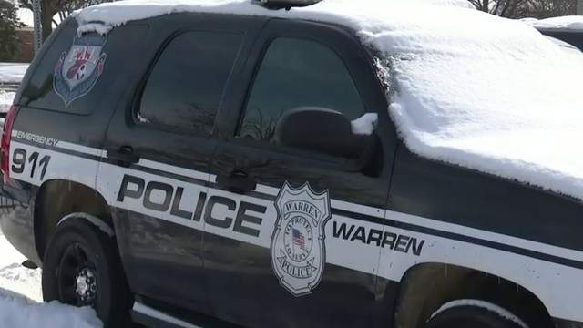 Warren police vehicle covered in snow (WDIV)