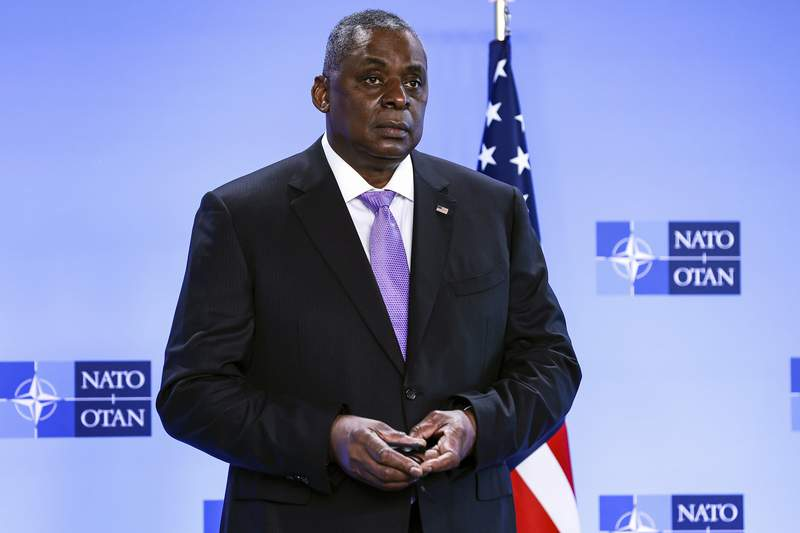 FILE - In this April 14, 2021, file photo, Secretary of Defense Lloyd Austin poses for photographers as he arrives at NATO headquarters in Brussels. The Associated Press has learned that a Pentagon panel is recommending that decisions to prosecute service members for sexual assault be made by independent authorities, not commanders. It would be a major reversal of military practice and a change long sought by Congress members. (Kenzo Tribouillard, Pool via AP)