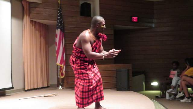 George Otieno performs his African storytime in traditional attire.
