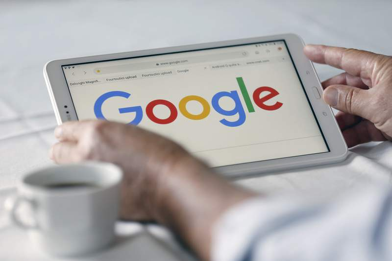 The Google logo is displayed on the screen of a tablet.