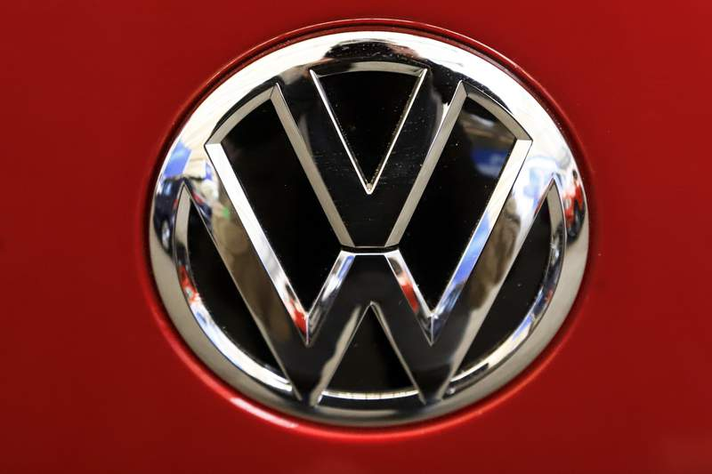 FILE - This Feb. 14, 2019, file photo, shows the Volkswagen logo on an automobile at the 2019 Pittsburgh International Auto Show in Pittsburgh.   The U.S. governments road safety agency has opened two investigations into problems with Volkswagen vehicles, including one that alleges serious gasoline leaks under the hood. Details of the probes covering nearly 215,000 vehicles were posted Friday, April 2, 2021, on the National Highway Traffic Safety Administration website.  (AP Photo/Gene J. Puskar, File)