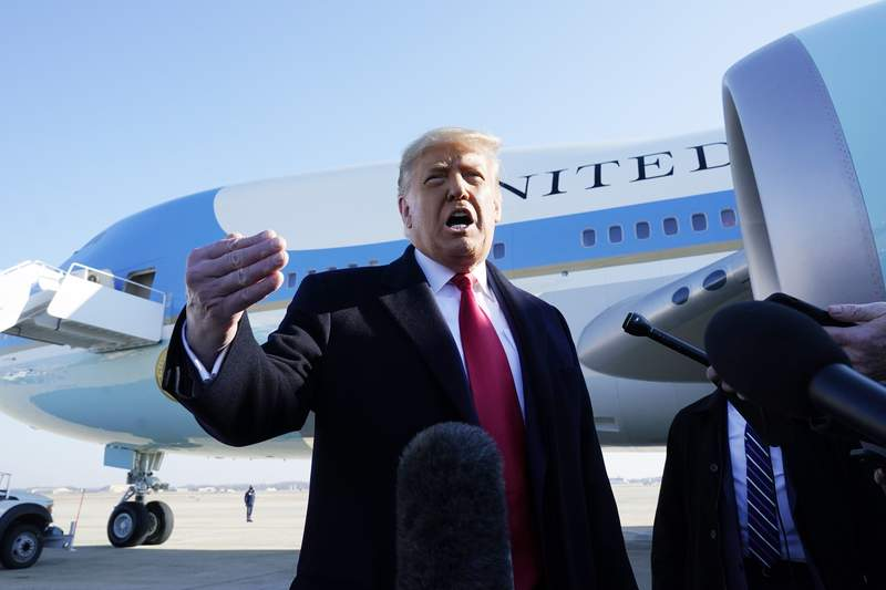 President Donald Trump speaks to the media before boarding Air Force One, at Andrews Air Force Base, Md. The President is traveling to Texas. (AP Photo/Alex Brandon)