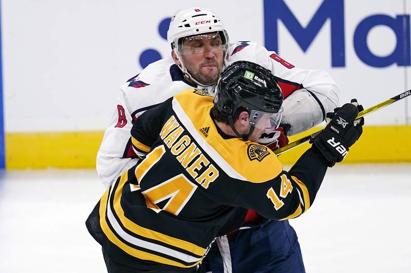 Washington Capitals left wing Alex Ovechkin (8) checks Boston Bruins right wing Chris Wagner (14) during the second period of an NHL hockey game, Wednesday, March 3, 2021, in Boston. (AP Photo/Charles Krupa)