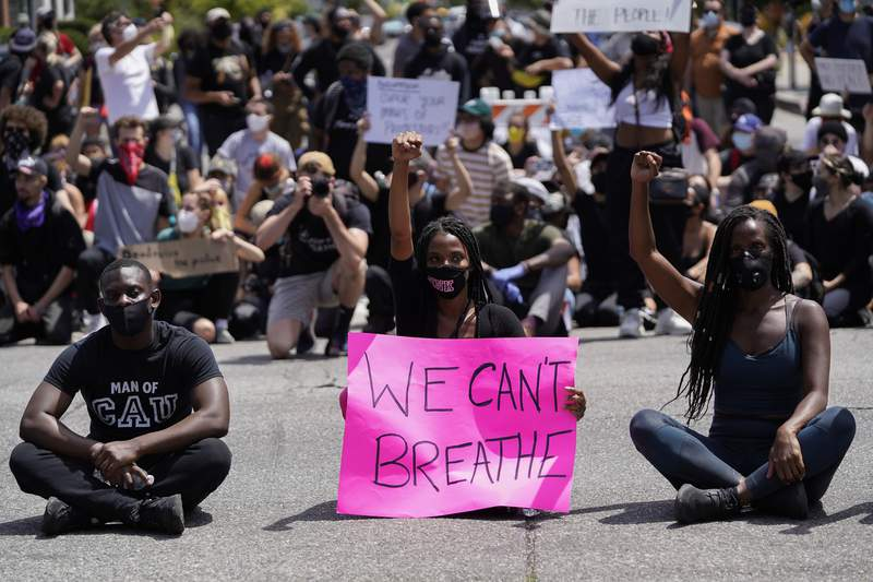 Protesters sit at an intersection in West Hollywood during demonstrations following the recent death of George Floyd on May 30, 2020. (Photo by Warrick Page/Getty Images)