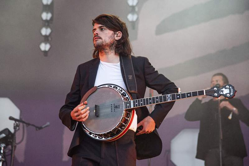 """FILE - In this Sunday, May 26, 2019 file photo, Winston Marshall of Mumford & Sons performs at the BottleRock Napa Valley Music Festival at Napa Valley Expo, in Napa, Calif.  Marshall says he is leaving folk-rock group Mumford & Sons so that he can speak freely about political issues. Marshall took a break from the band in March after sparking a social media storm by tweeting admiration for  a book by right-wing writer-activist Andy Ngo. Marshall was accused online of endorsing the far right, but said Thursday, June 24, 2021 that nothing could be further from the truth.""""( Photo by Amy Harris/Invision/AP, File)"""