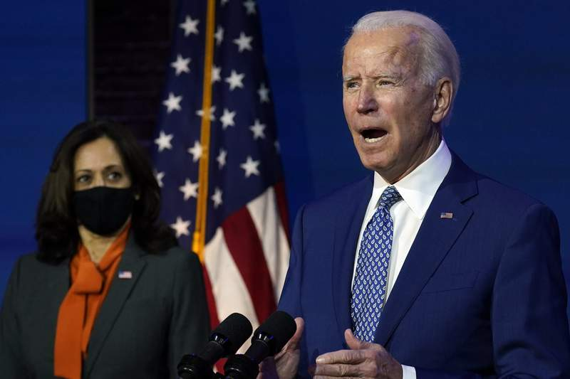 President-elect Joe Biden, joined by Vice President-elect Kamala Harris, speaks at The Queen theater, Monday, Nov. 9, 2020, in Wilmington, Del. (AP Photo/Carolyn Kaster)