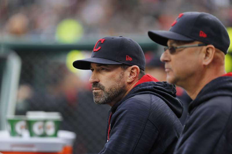 FILE - Cleveland Indians pitching coach Mickey Callaway, left, watches with manager Terry Francona during the first inning of a baseball game against the Detroit Tigers, in Detroit, in this May 3, 2017, file photo. Indians manager Terry Francona said no one in the Cleveland organization covered up for former pitching coach Mickey Callaway, who is under investigation by Major League Baseball following allegations of sexual harassment.  In a story Tuesday, March 2, 2021, The Athletic reported that 12 current and former Indians employees have come forward in the last month to say the Indians were aware of Callaways inappropriate behavior while he was their pitching coach from 2013-17. (AP Photo/Paul Sancya, File)