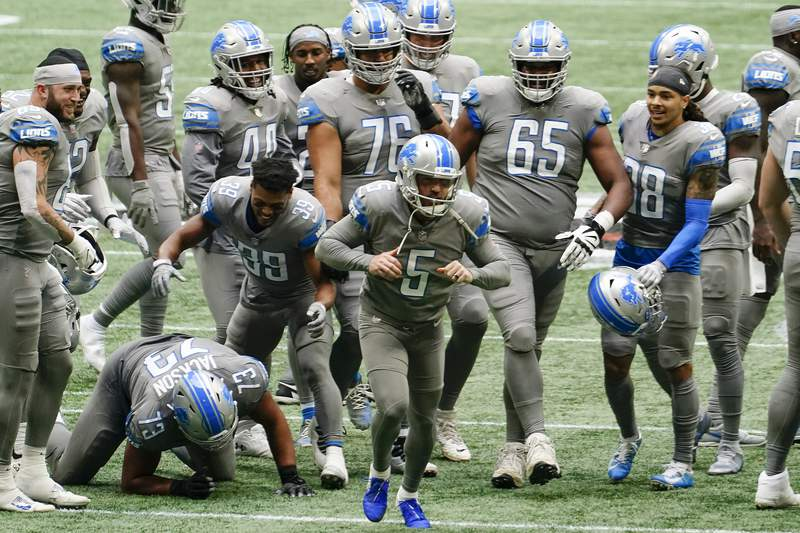 Detroit Lions kicker Matt Prater (5) celebrates a game-winning extra point against the Atlanta Falcons during the second half of an NFL football game, Sunday, Oct. 25, 2020, in Atlanta. The Detroit Lions won 23-22. (AP Photo/Brynn Anderson)