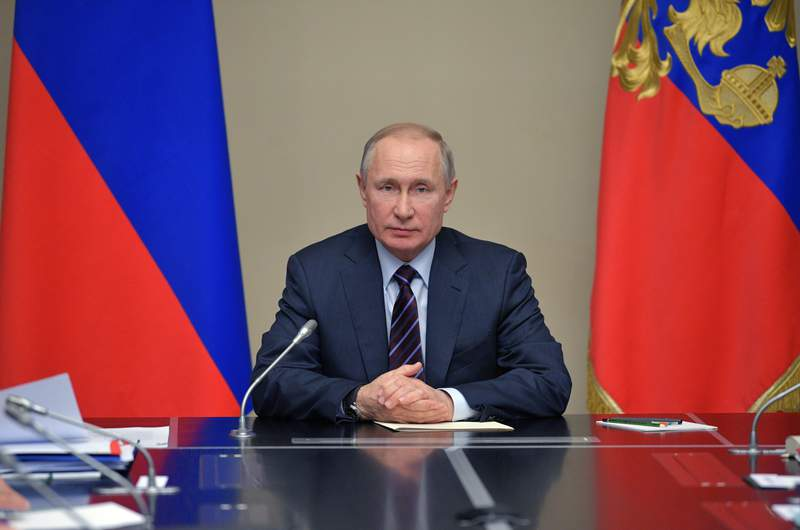 Russian President Vladimir Putin chairs a Security Council meeting at the Novo-Ogaryovo residence outside Moscow Moscow, Russia, Friday, Feb. 21, 2020. (Alexei Druzhinin, Sputnik, Kremlin Pool Photo via AP)