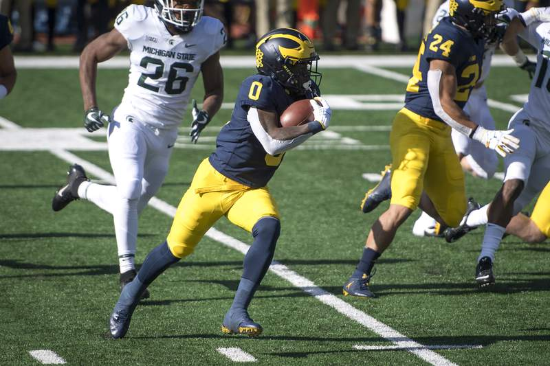 Giles Jackson #0 of the Michigan Wolverines runs the ball during the first quarter against the Michigan State Spartans at Michigan Stadium on October 31, 2020 in Ann Arbor, Michigan.