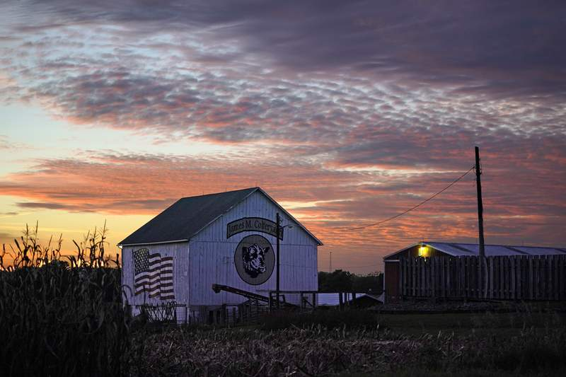 The sun sets on a farm in Sarver, Pa., in Butler County on Wednesday, Oct. 14, 2020. To win Pennsylvania, President Donald Trump needs blowout victories and historic turnout across the state in conservative strongholds such as Butler County. (AP Photo/Gene J. Puskar)