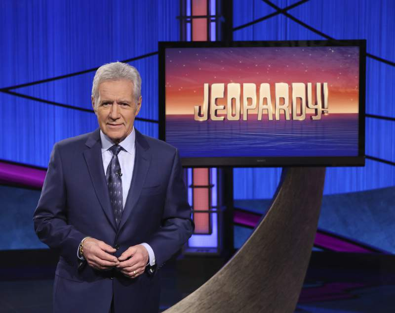 "This image released by Jeopardy! shows Alex Trebek, host of the game show ""Jeopardy!"" Trebek's memoir, ""The Answer Is: Reflections on My Life,"" will be released on Tuesday, July 21. (Jeopardy! via AP)"