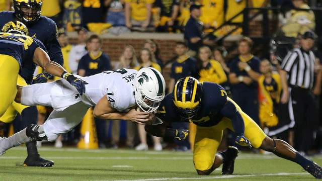 Brian Lewerke dives for the end zone against Michigan on Oct. 7, 2017, in Ann Arbor. (Leon Halip/Getty Images)